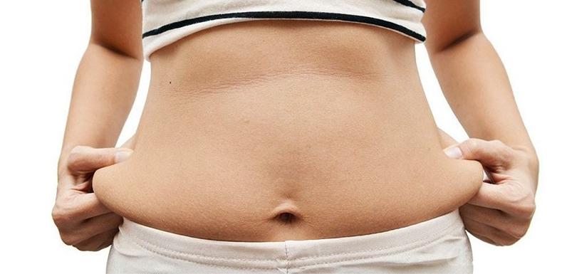 Причины скопления жира на животе